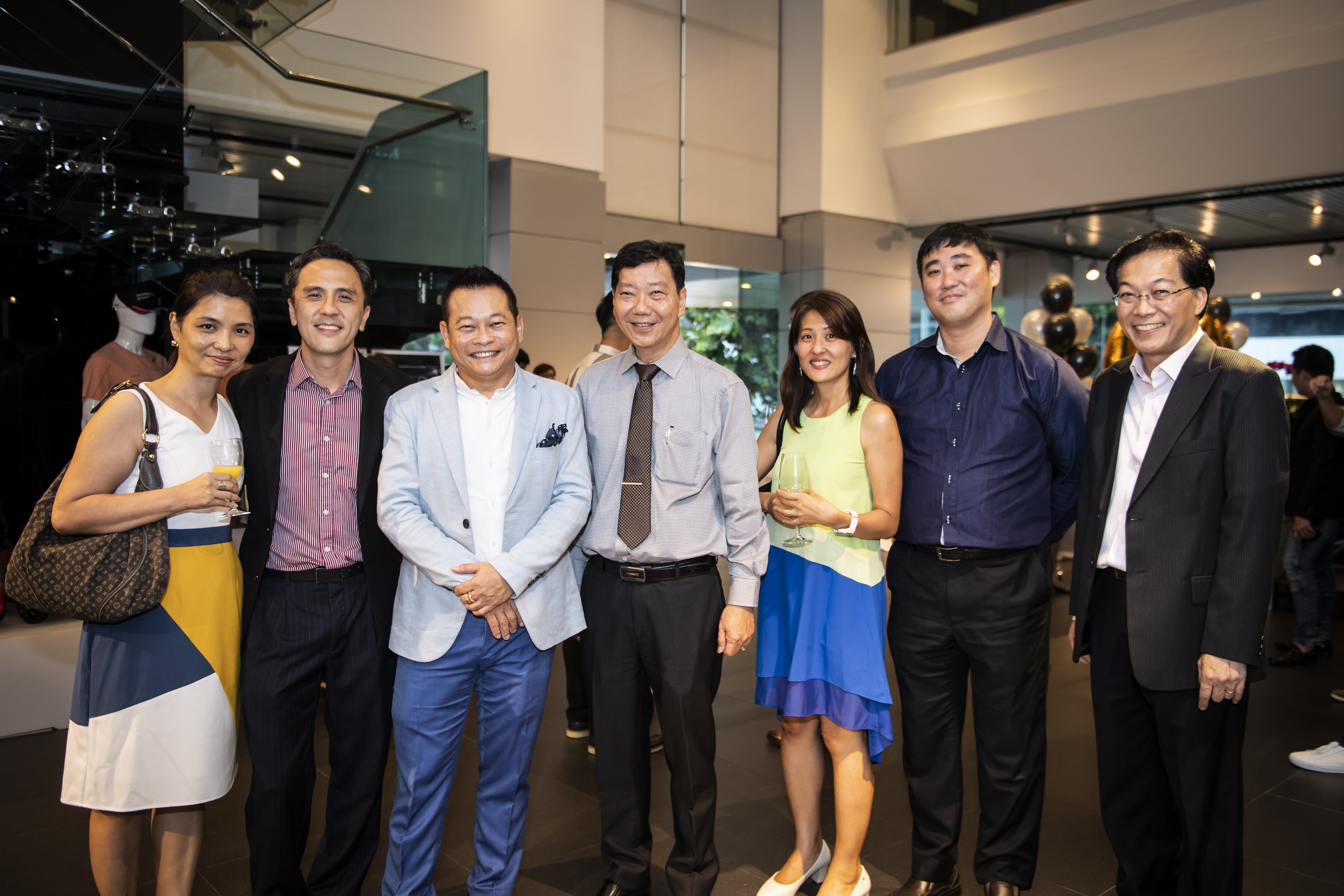 Mr Francis Lee, Managing Director of Stuttgart Auto (centre) and Mr Joe Goh (third from left), together with Porsche guests at the celebratory delivery party held at Porsche Centre Singapore