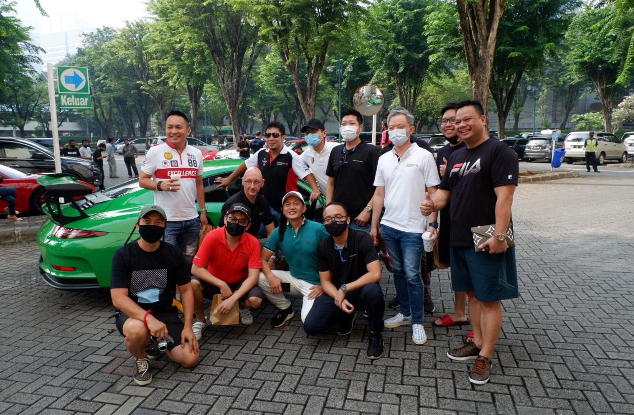 Mr Jason Broome, Managing Director of Porsche Indonesia together with guests at the Cars and Coffee event