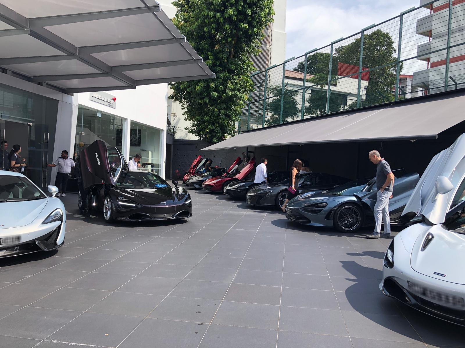 The McLaren owners getting ready to set out in a convoy from the McLaren Showroom