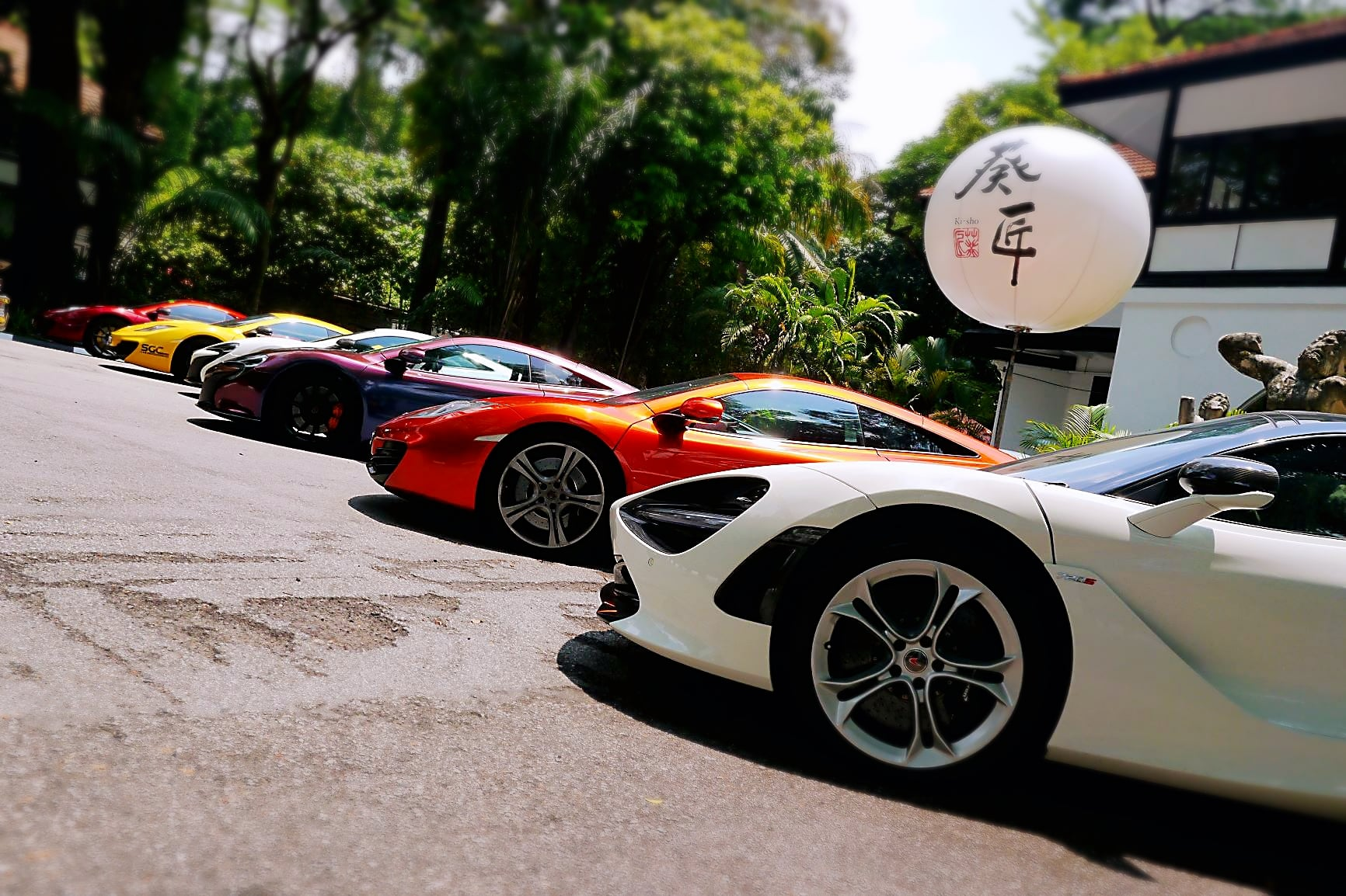The gaily coloured McLarens that lined up at the front of Buona Terra
