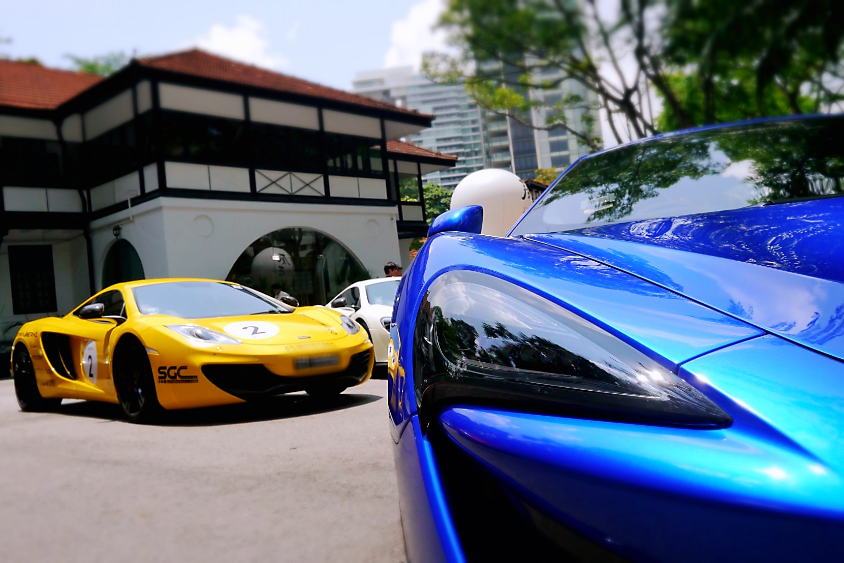 The timeless designs of the McLaren MP4-12C and the new McLaren 600LT set against the colonial architecture of the restaurant