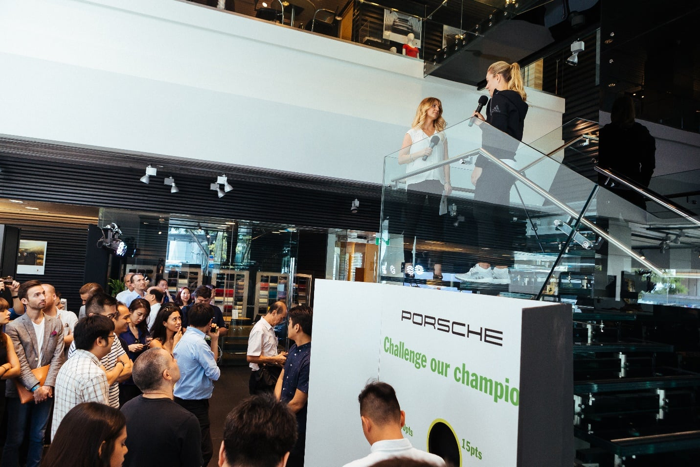 Emcee of the launch, Stephanie Woods Marketing Manager of Porsche Singapore (left) and Angelique Kerber