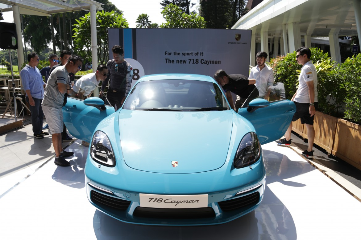 Porsche Club Indonesia members scrutinising the New 718 Cayman