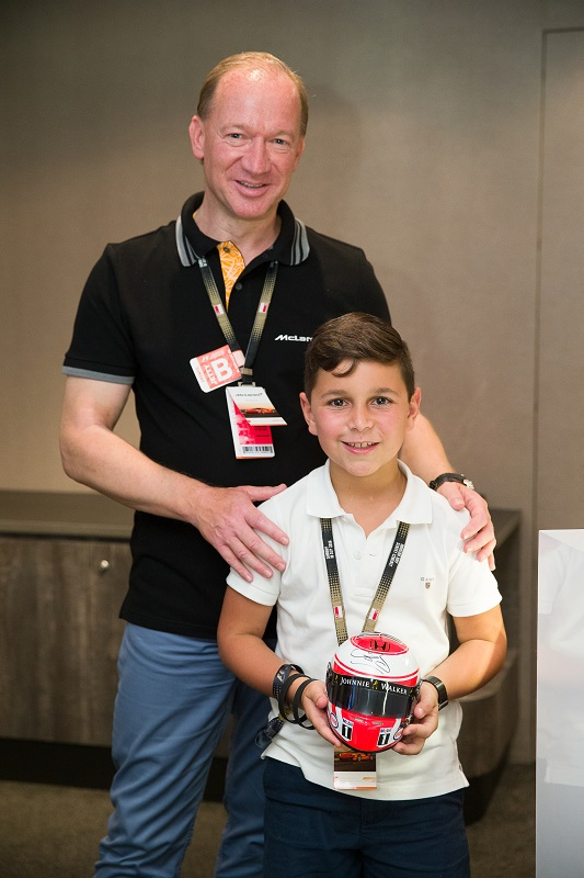 McLaren Automotive CEO, Mike Flewitt, presenting a lucky draw prize to a McLaren fan boy