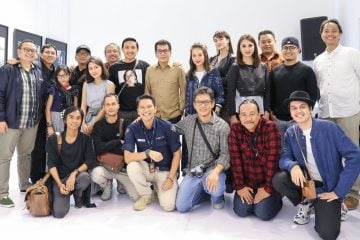 "The participants of the ""SHADOW"" photography exhibition who are from the NET Photography community posed together at the Eurokars Gallery, Plaza Indonesia, Jakarta"