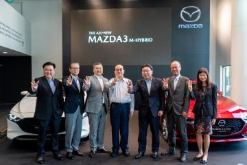 Representatives of Eurokars Group and Mazda Motor Corporation pose for group photo at the Exclusive Media Showcase of the All-New Mazda3 in Singapore