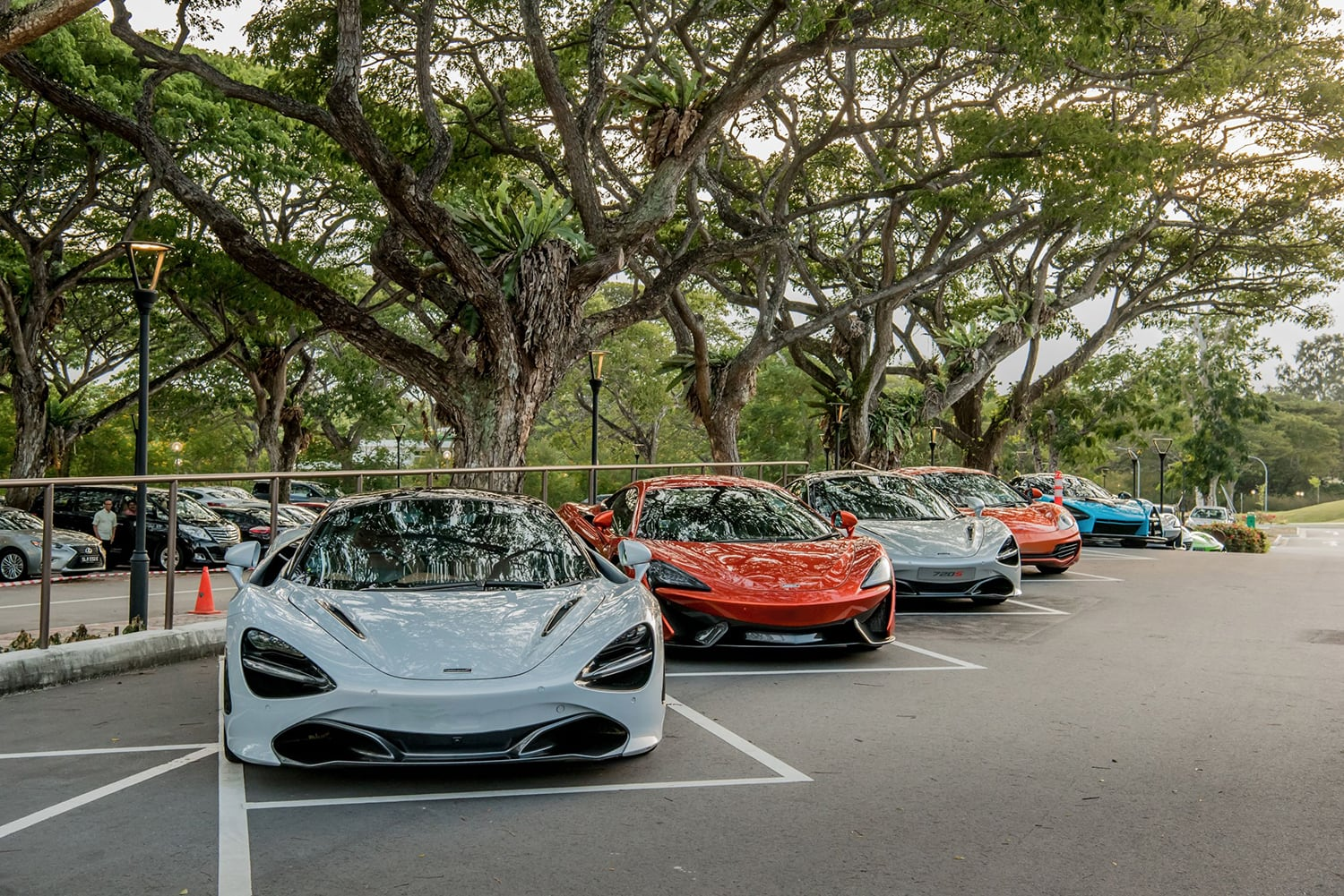 The line-up of McLarens outside Tanah Merah Country Club